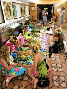 Festive sights - Polynesian night aboard the Paul Gauguin. Locals teaching passengers how to make flower headdress and lei